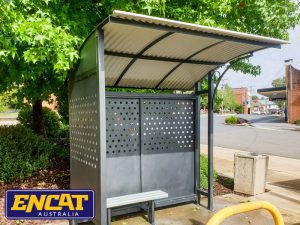 Grey outdoor bus shelter aluminium with roof and seat custom made in any colour by ENCAT in Australia for corners