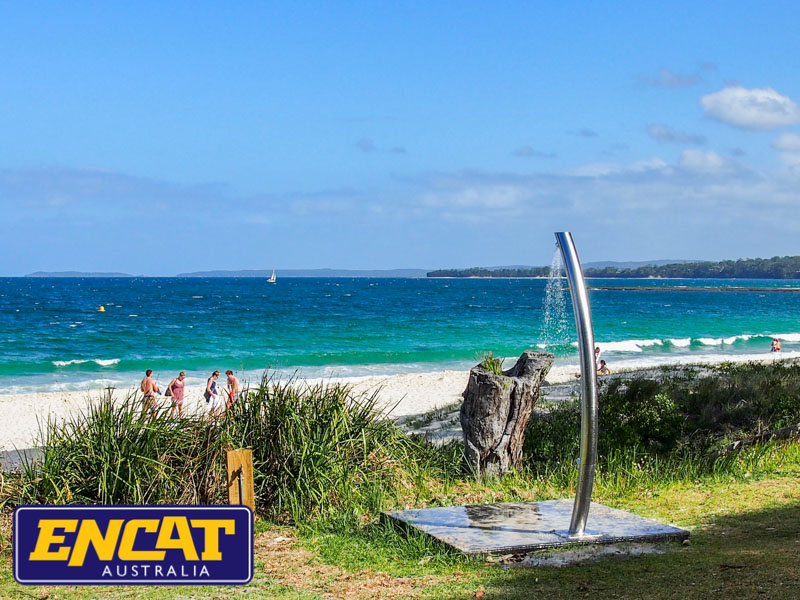 Pipeline-Pete-stainless-steel-outdoor-beach-shower-made-by-ENCAT-installed-on-the-grass
